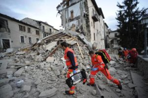 Rescuers search a crumbled building in Arcuata del Tronto, central Italy, where a 6.1 earthquake struck just after 3:30 a.m., Wednesday, Aug. 24, 2016. The quake was felt across a broad section of central Italy, including the capital Rome where people in homes in the historic center felt a long swaying followed by aftershocks. (ANSA/AP Photo/Sandro Perozzi) [CopyrightNotice: ap]